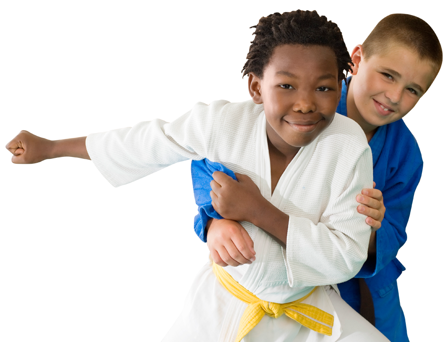 two young boys wrestling in karate uniforms